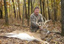 Deer hunter with trophy buck