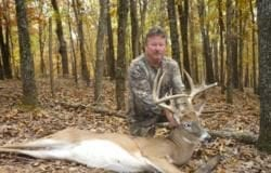 Deer hunter with trophy buck
