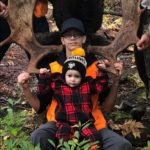 Photo of Brandon Ryan and Baby Jaxson from our October 4th. 2018 Neil's Harbour Cape Breton Moose Hunting Trip. The Moose was shot by Kris Kirk with a Browning 300 Magnum.