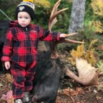 A Future Hunter in the Making! Photo of Baby Jaxson with a nice Bull Moose harvested on our October 4th. 2018 Neil's Harbour Cape Breton Moose Hunting Trip. The Moose was shot by Kris Kirk with a Browning 300 Magnum.