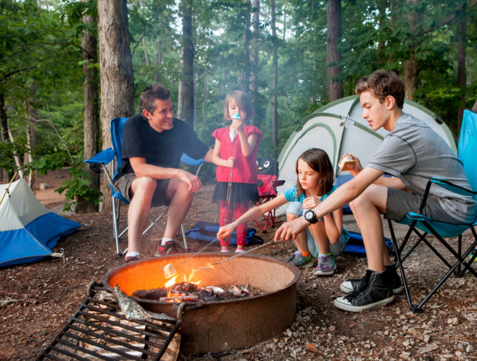 Father Camping in the Outdoors with Children | Hunting Magazine