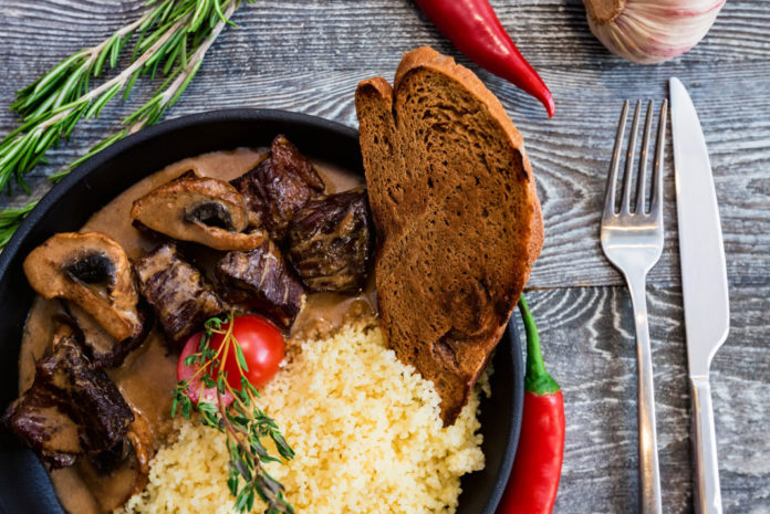 Pan Fried Pecan Venison Backstrap with Mushroom Served with Toast | Hunting Magazine